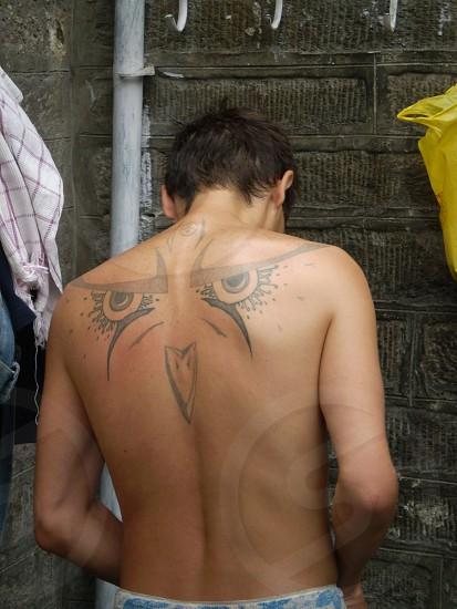 Beautiful eyes tattoo on the back photo