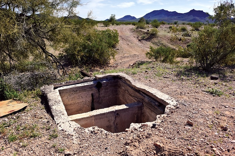 The remains of an old septic tank in the ghost town of Sundad Arizona. Sundad began in the 1920s as a TB Sanitarium but when a viable treatment was discovered in the 1940s the Sanitarium was abandoned. Sundad lies within federal BLM land. photo