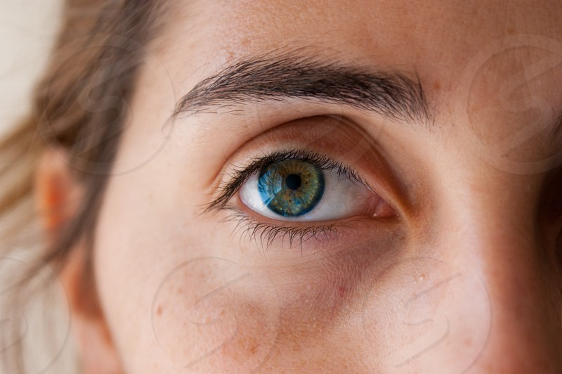 green blue and brown eyes of a woman photo