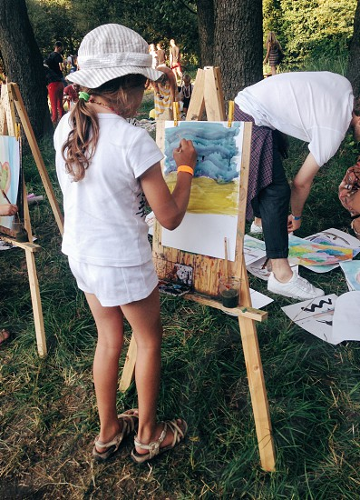 girl painting on easel photo