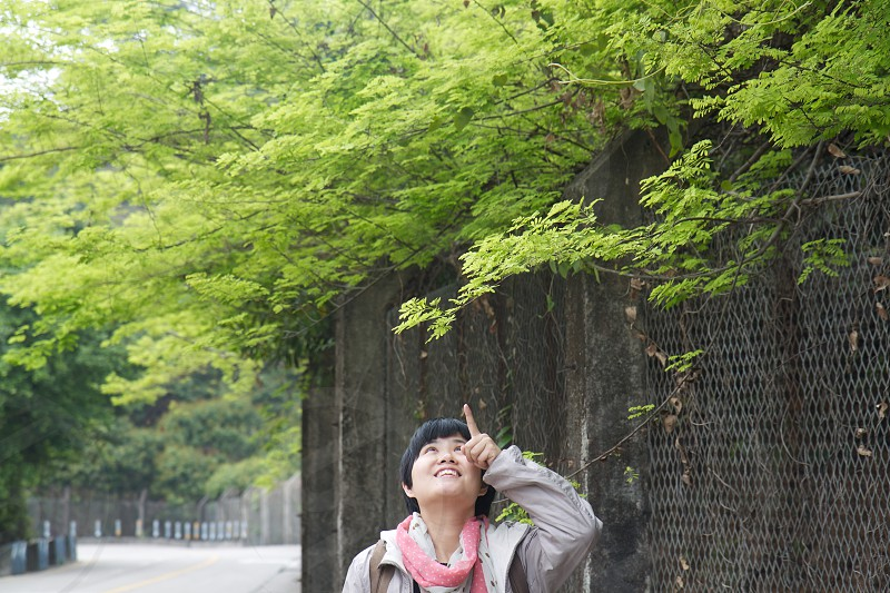 a girl delighted by the new leaves in spring photo