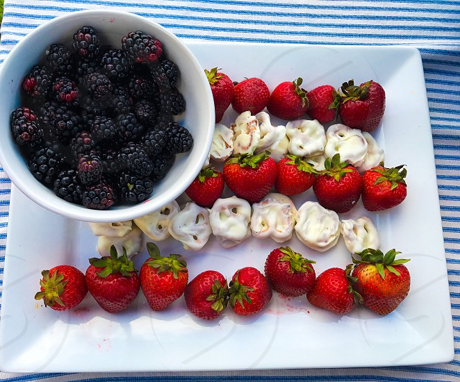 Blueberries strawberries cookies red white and blue fourth of July flag treats snacks picnic photo