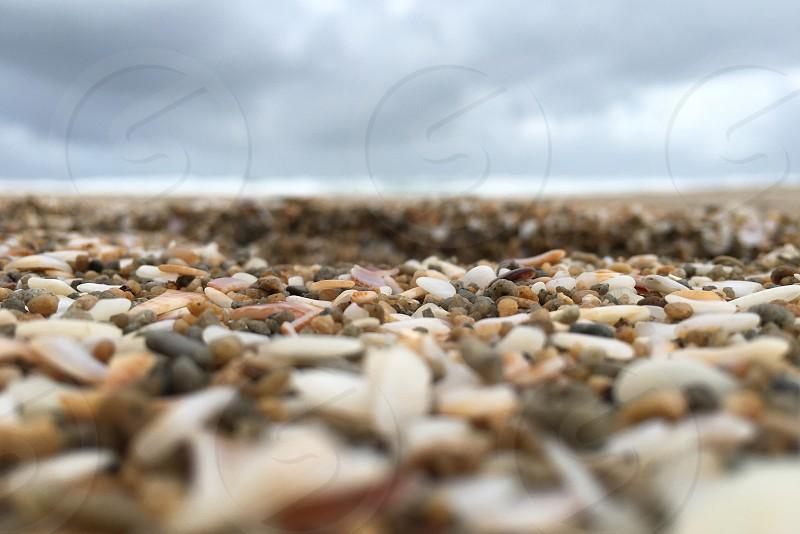 sea stones under grey clouds photo