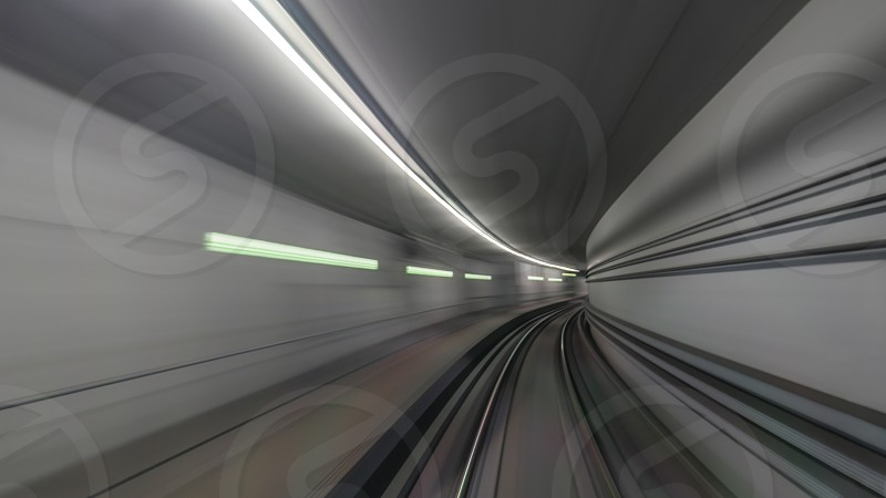 View on subway rails in tunnel from train photo