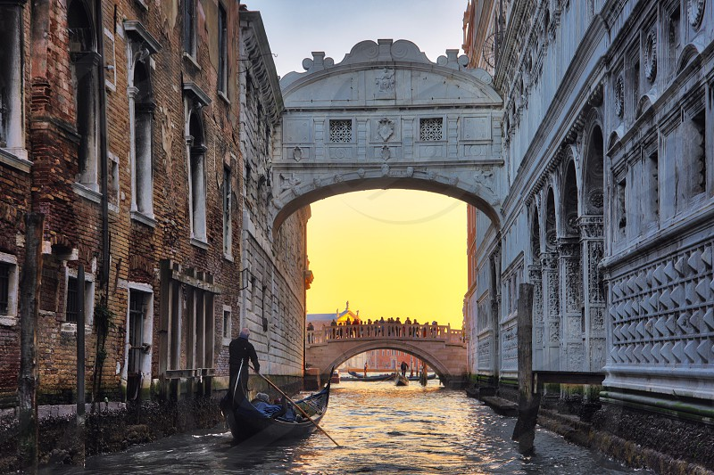 view of the bridge of sighs in venice with a gondola photo