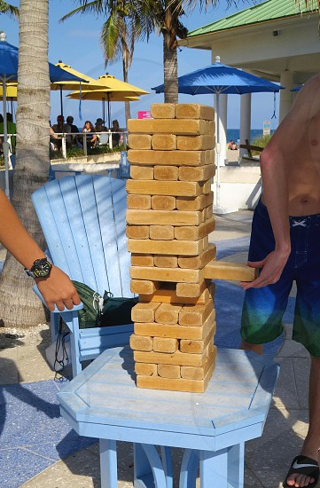 A game of jenga at the beach photo