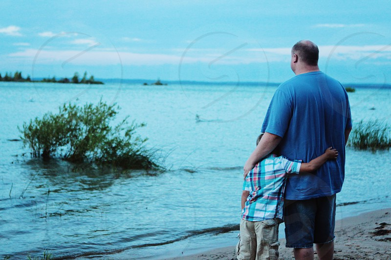 Father and son on Lake Michigan photo