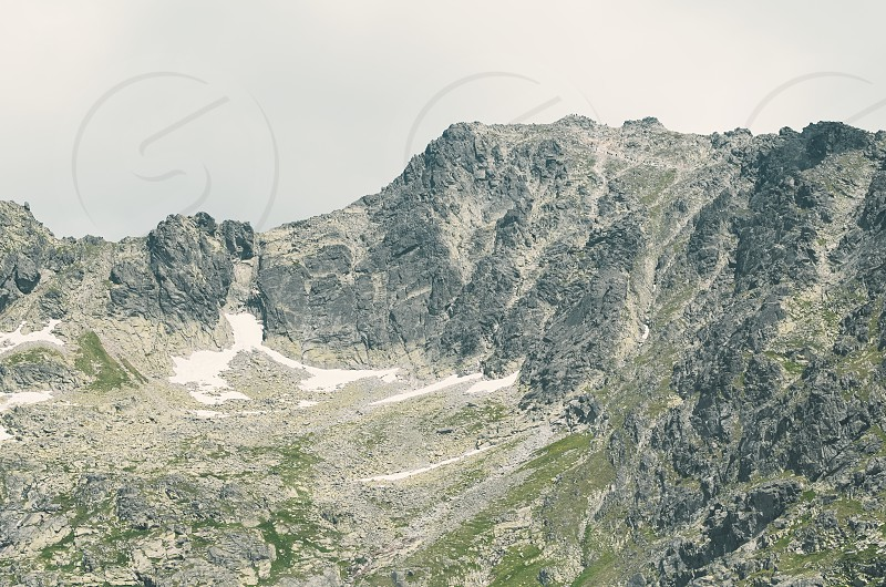 Peak Rysy in High Tatras with Mountaineers on a Summer Day photo