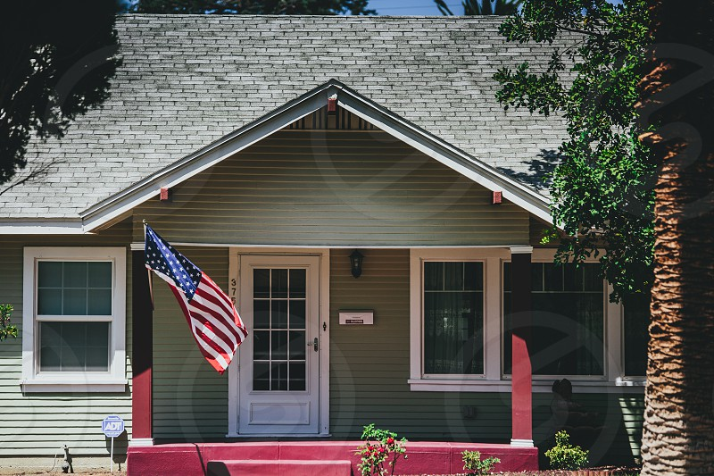 gray house with american flag photo