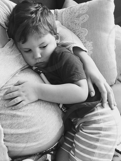 Cuddles pregnancy son mother photo
