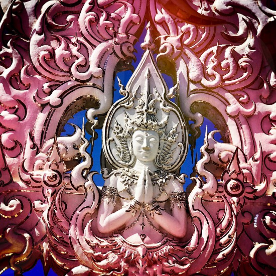 Outdoor day square filter colour Wat Rong Khun The White Temple Chiang Rai Thailand Thai Kingdom of Thailand travel tourism tourist wanderlust summer summertime temple Buddhist Buddhism spiritual pure holy dragon monster carved ornate elaborate art modern sculpture sculpted east eastern hands silver mirror mosaic magical mythical blue sky Buddha contrast screen photo