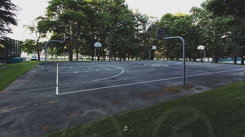 multiple hoops at a basketball court photo