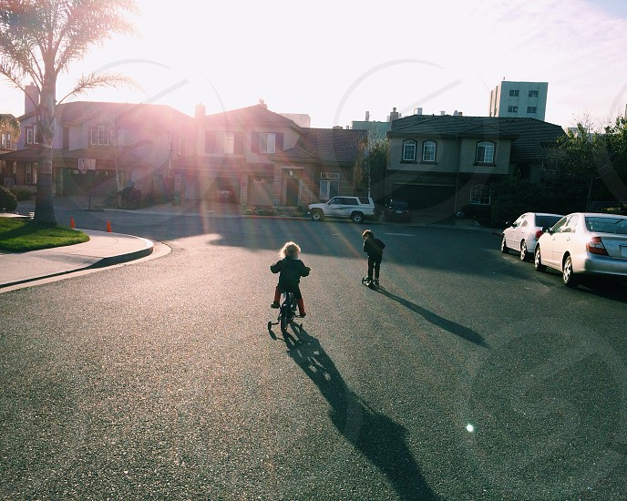 2 boys on a bicycle view  photo