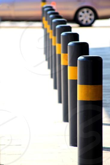 Row of black restrictive posts with yellow reflectors Phnom Penh Cambodia photo