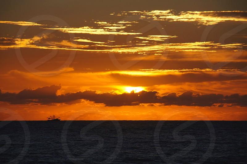 Daytona Beach Florida sunrise Atlantic ocean boat photo