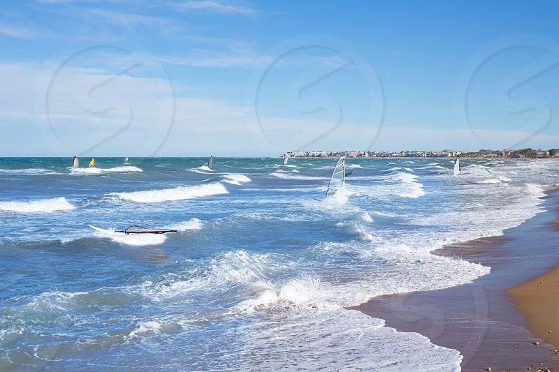 Wind surf in Denia Oliva in Valencian community Mediterranean blue sea of spain photo