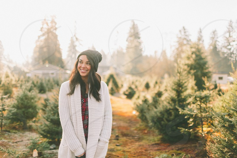 A young woman at the Christmas Tree farm.  photo