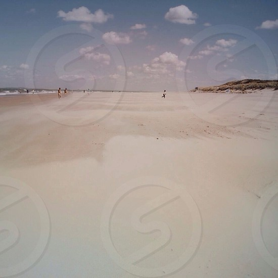 view of people on white sand beach photo