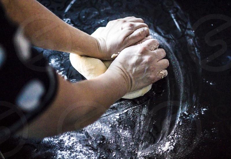 Woman squeezes dough photo