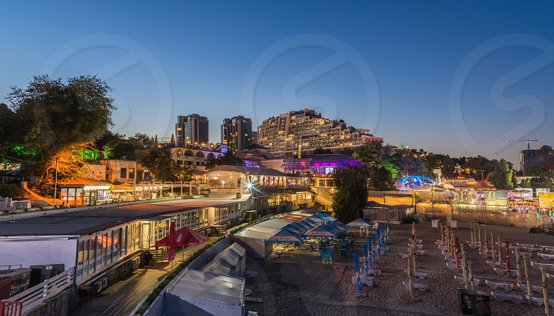 ODESSA UKRAINE - 08.08.2018. Panoramic view of Arcadia city beach in a hot summer night. Famous touristic place in Ukraine photo