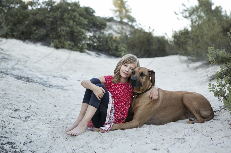 pet dog large breed dog Rhodesian ridgeback girl companion buddy family friends friendship love embrace embracing hugging loving tender sweet companionship family  photo