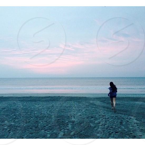 woman running on beach sand photography photo