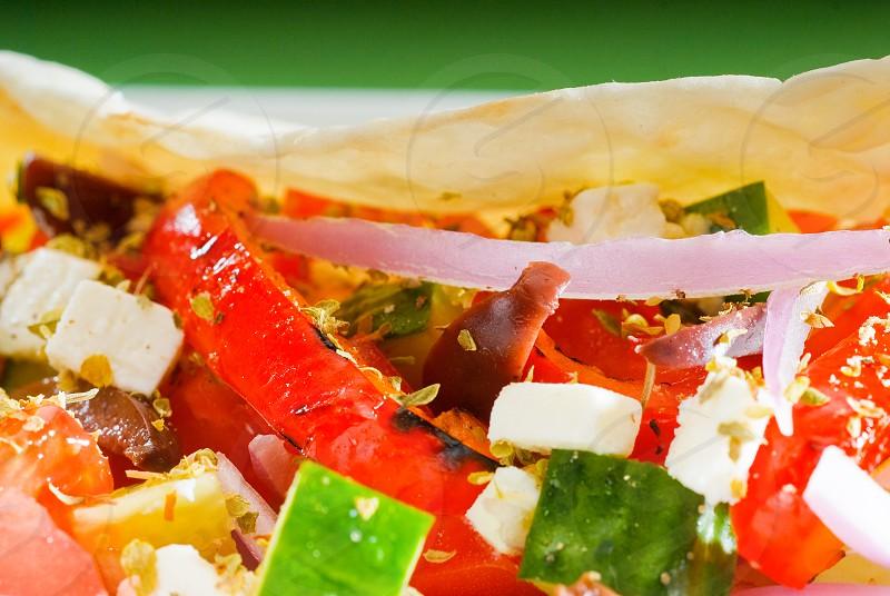 fresh homemade salad wrap on pita breadvery healthy food photo