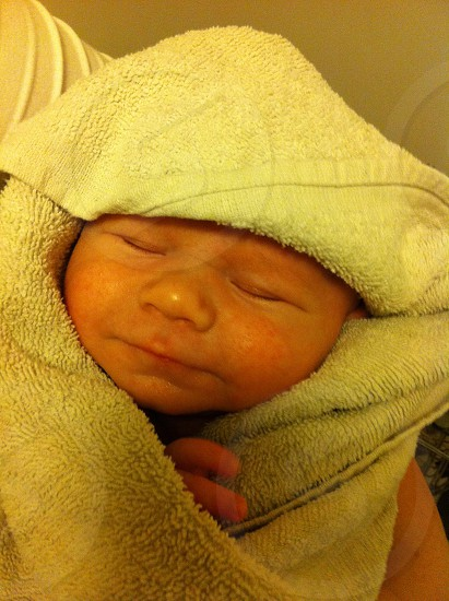 baby wrapped in a towel  photo