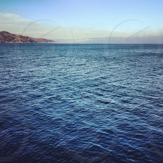 ocean with mountain panoramic photography photo