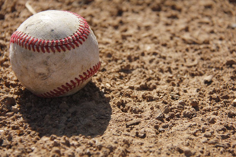 Baseball lonely in the dirt waiting to play again tomorrow  photo
