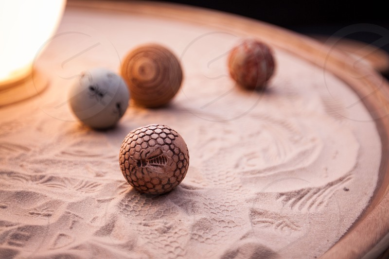 round brown ball on sand ornament photo
