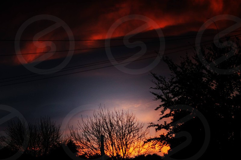 Sky. Burning. Fire. Sunset. Sunrise. Red sky. Orange sky. Silhouette. Landscape.  photo