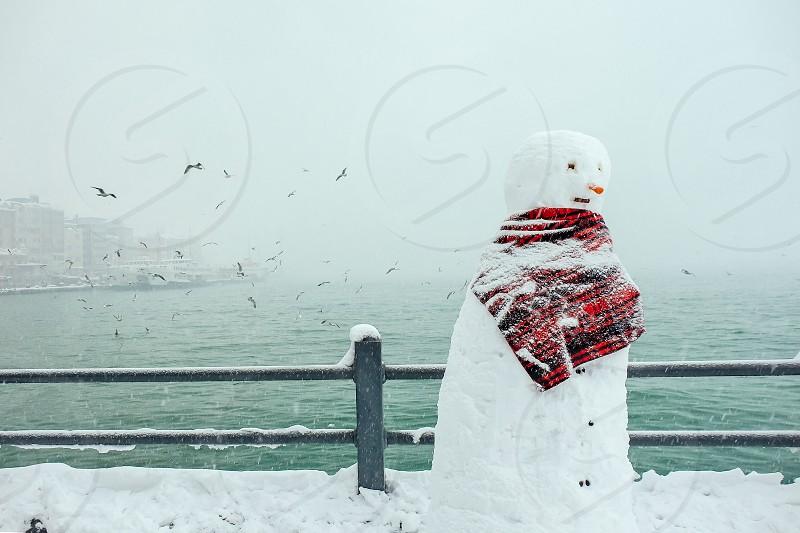 Snow man on the Galata Bridge photo