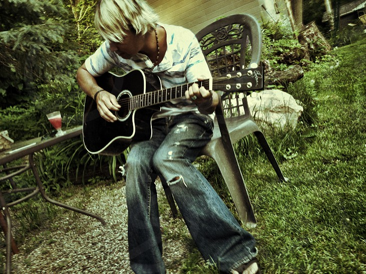 Young man playing the guitar photo