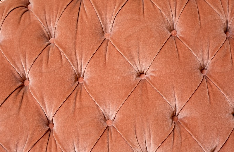 Close-up of a coral colored chair cushion photo