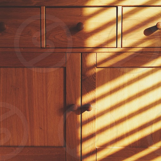 brown wooden cabinet and drawers photo