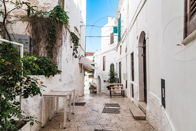 Ostuni Italy - August 2019: Historic center of white city of Ostuni in Puglia in a day of August photo