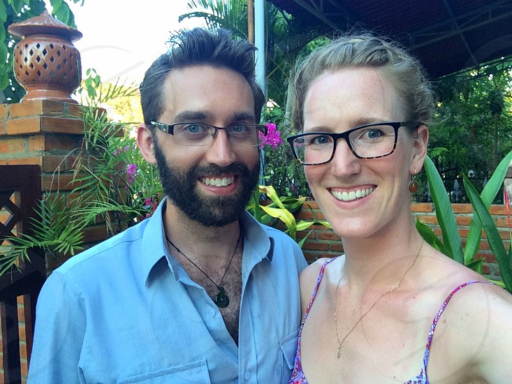 happy young couple glasses selfie beard smiling photo