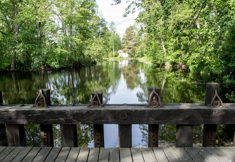 Wooden bridge over a lake on a small 1800´s town in Sweden. photo