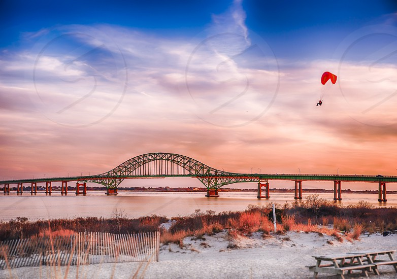 Chance encounter with a Paraglider sailing over the Great South Bay on Long Island NY photo