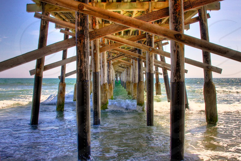 A new perspective under a wooden pier. photo