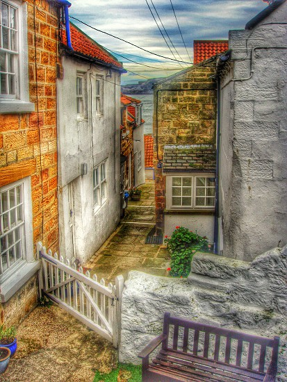 Cobbledstreetredrooffishingvillagegatehouses photo
