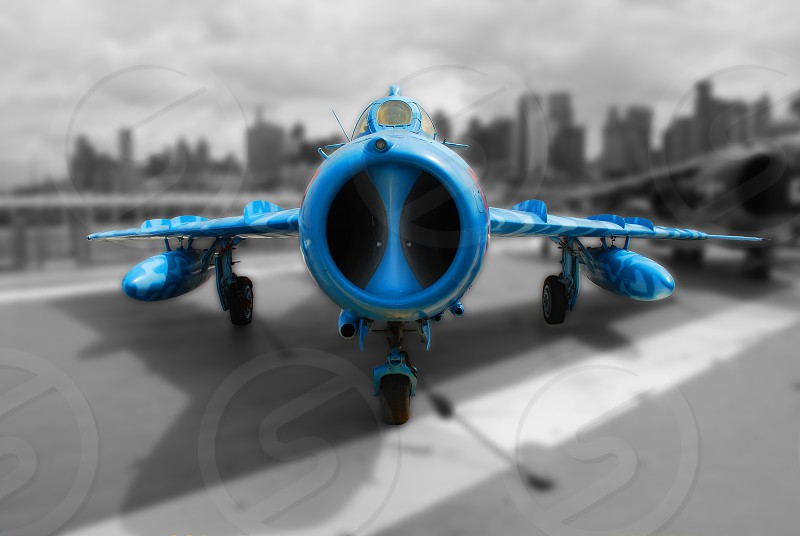selective focus photography of blue painted jet plane photo