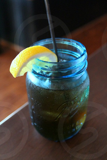 Iced tea in blue ball jar photo