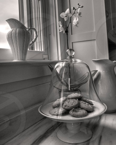 Cookies and vase by window photo