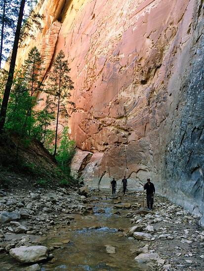 men in black overall walking on rocks photo