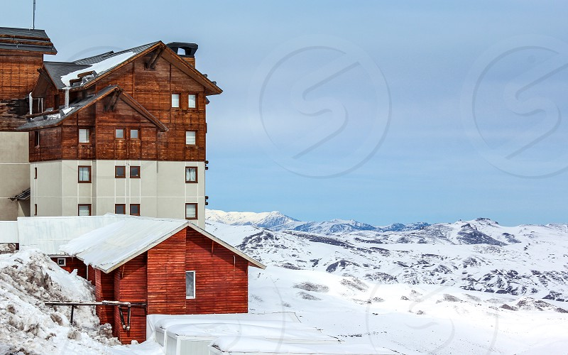 brown and white wooden house under blue sky photo