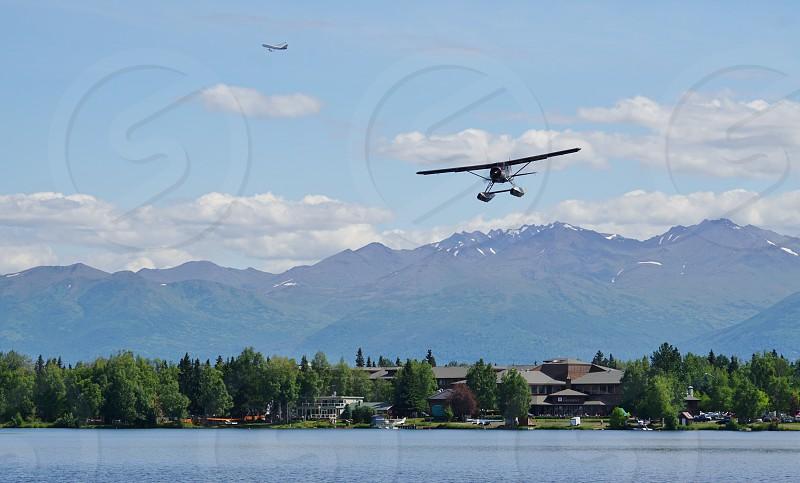 Adventure flying in a seaplane near Anchorage Alaska photo