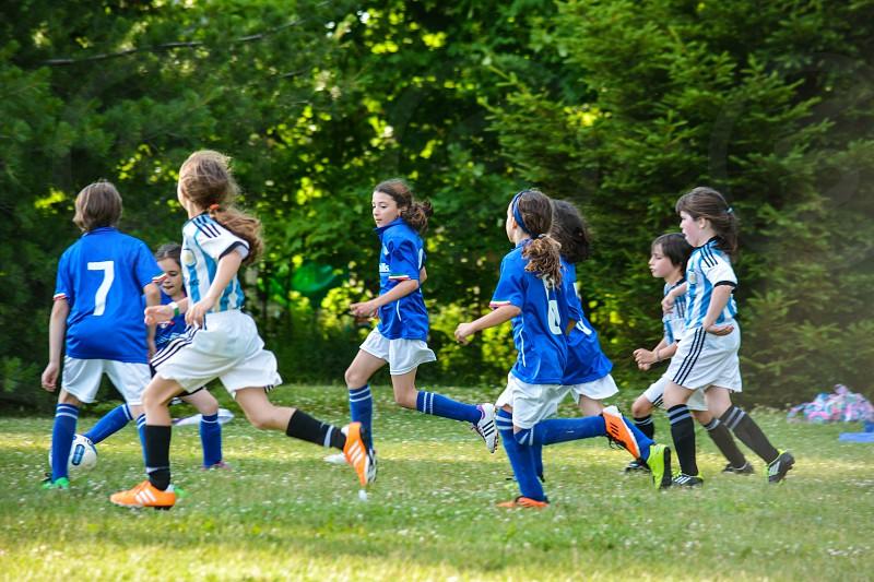 soccer girls ball green grass running photo
