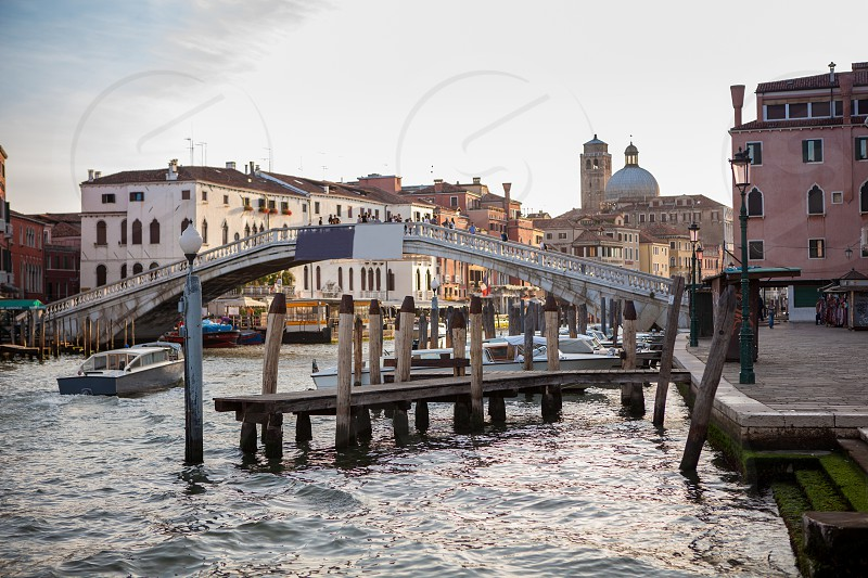 Beautiful view on tourist destination in Venice Italy - Grand Canal. Representation of gorgeous bridge over Canal. photo